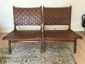 Pair of vintage mid-century teak and leather lounge chairs