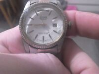 Rolex 1950 stainless steel date and time watch