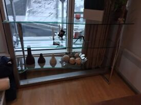 Beautiful glass display shelf bought from John Lewis 2 years ago for £700.00 ....selling for £300.00