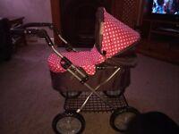 Childrens pink polka dot molly dolly pram