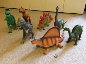 A selection of 7 dinosaur toys