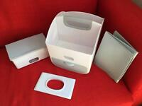 Ubbi Portable changing station, caddy and wipes dispenser.