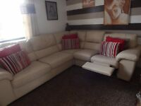 Italian leather corner sofa with built in double bed and one recliner chair