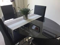 Dark glass and chrome dining table + chairs