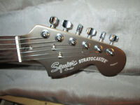 Squier Stratocaster Standard by Fender Indonesian rare Gunmetal w.gigbag,lead,picks,tuner,books