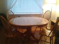 Extending pine table and 4 chairs £50 ono