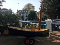 Beautiful Sailing Dinghy Boat with Outboard & Trailer