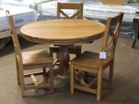 Ex-display**Solid oak round extendable table and 3 chairs - delivery available