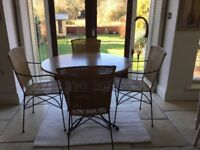 Circular dining table and four chairs.