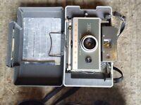 Poloroid camera and cine camera