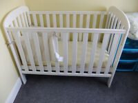 Lovely Kiddicare Anna Drop Side Cot with Mattress and some bedding