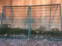 Two pairs of weld mesh gates with posts and mesh