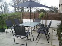 Patio set with 6 chairs and parasol