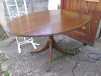 Mohogany dining table with brass feet