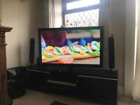 """55"""" Samsung LCD TV with remote control."""