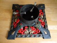 ornate cast iron Christmas tree stand - will hold water for a live tree