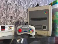 Super Nintendo games console with games Mario