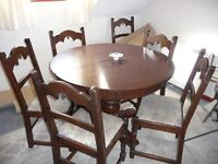 Beautiful dark oak dining table and 6 chairs