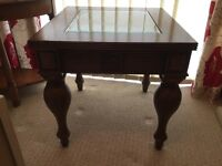 Large dark wooden coffee table / lamp table with glass centre top