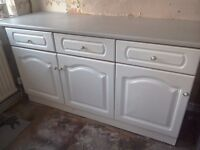 White kitchen units and cooker