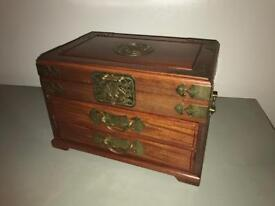 Wooden jewellery box with brass fittings