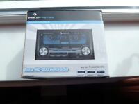 Car Radio with MP3-Compatible USB and SD slots, AUX input and FM radio reception.