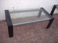 GLASS COFFEE TABLE AND MATCHING SIDE TABLE.