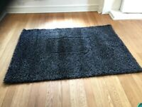 Rug - black colour with charcoal bits