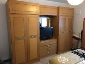 Large wardrobe and bedroom storage unit.