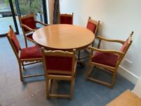 Elegant antique round oak table and 6 chairs