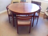 Nathan solid teak extending table and four chairs
