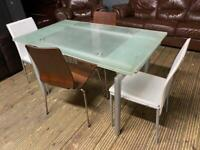GLASS DINING TABLE is EXTENDABLE WITH 4 CHAIRS