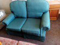 Free to collecter two two seater sofas.