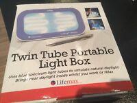 Twin tube portable light box