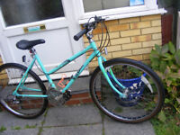 "LADIES RALEIGH 26"" WHEEL BIKE WITH FITTED LIGHTS IN GREAT WORKING ORDER"