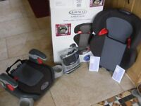Graco Childs safety seat new in box with extras.