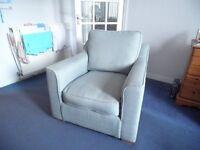 Arm chair . aosta mint with light wood feet .
