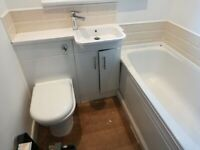 white wash hand basin and chrome mixer tap