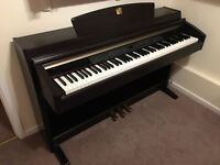 Yamaha Clavinova CLP 240 dark rosewood with adjustable stool