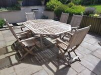 Westminster teak garden table with integral extra leaf + matching folding chairs x6
