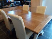 Large solid chestnut dining table with 6 chairs selling at £ 450
