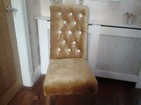 Two newly reupholstered Gold velvet dinning chairs