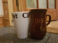 Two perfect condition hot choc mugs