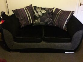 Black 2 seater fabric sofa / settee silver grey trim with purple accent cushions very comfy