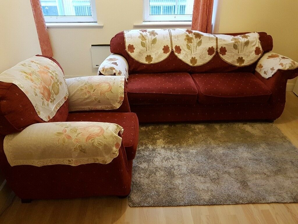 Generous maroon colour 3 seater sofa and a single chair set.
