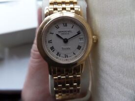 Raymond Weil gold plate ladies watch. Champagne face, bracelet strap