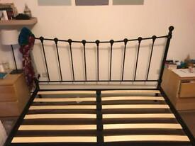 Black metal superking bed.