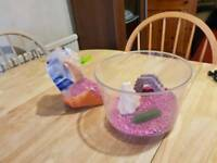 Fish bowl with ornaments and gravel