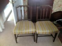 Two Hepplewhite-style dining chairs (sold as a pair)