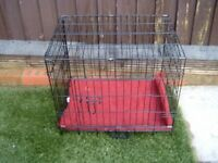 Folding wire mesh dog bed/travelling crate with mattress.
